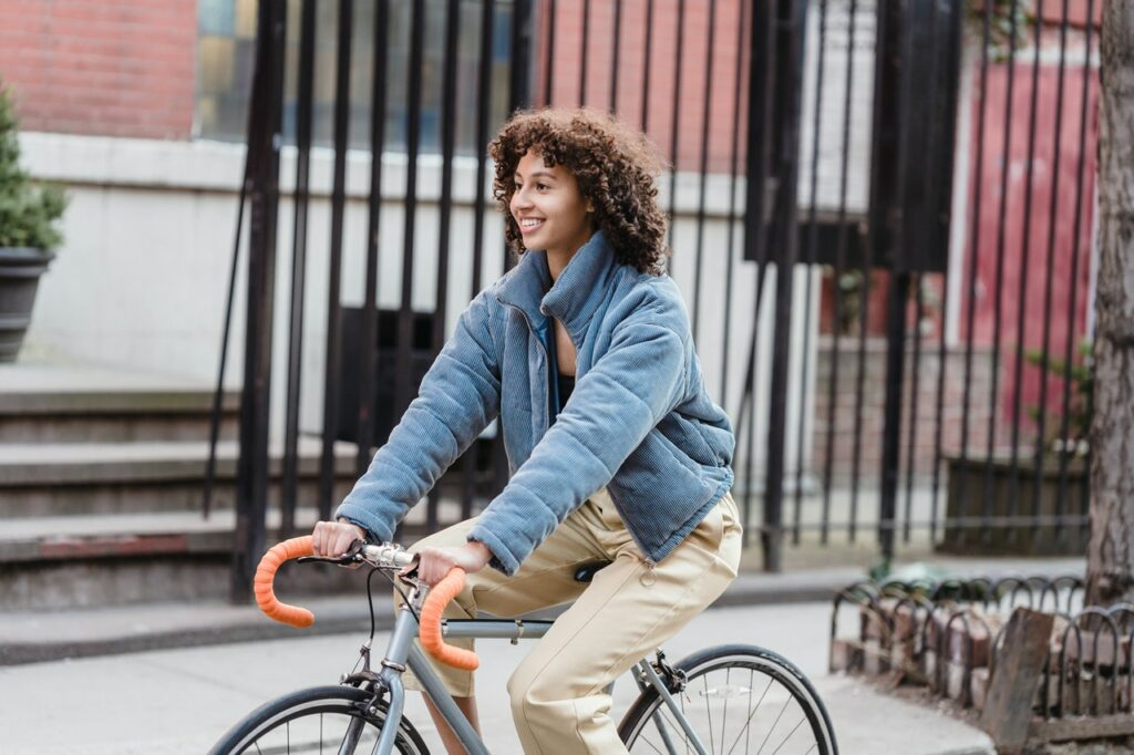 a-girl-rides-a-bike-rented-for-extra-money