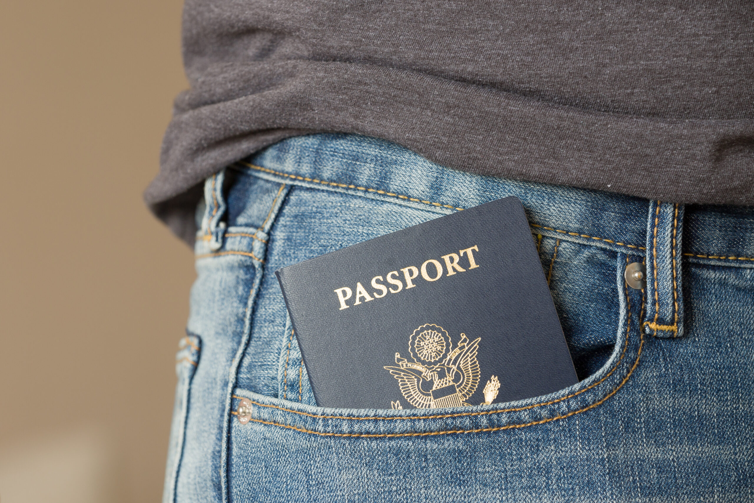 Closeup of US passport in jeans pocket