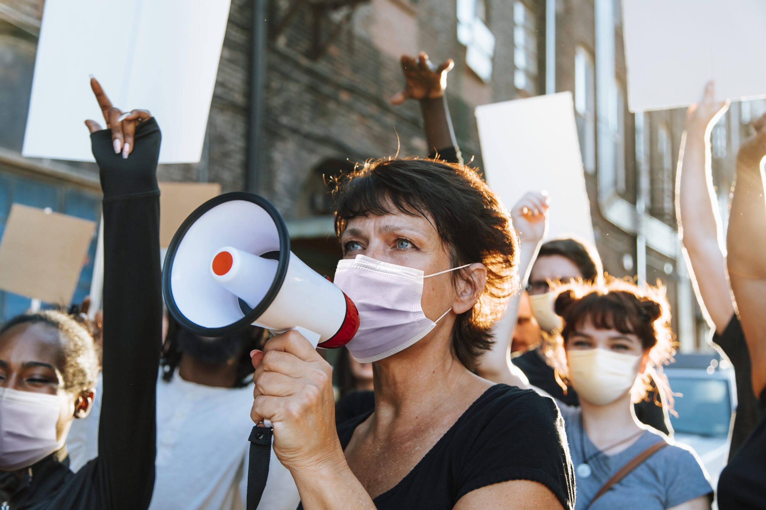 Diverse people wearing mask protesting during COVID-19 pandemic